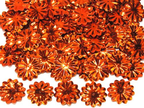 cekiny słońca z promieniami pomarańczowe